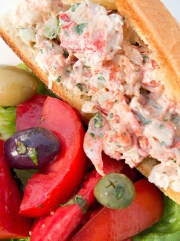 overhead view of a lobster roll and tomato salad