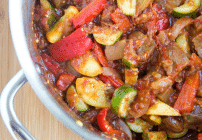 overhead partial view of a pot with cooked ratatouille