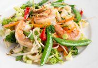 shrimp stirfry in a white bowl