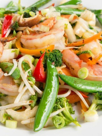 shrimp stirfry in a white bowl