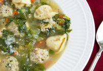 partial overhead view of a white bowl of Italian wedding soup