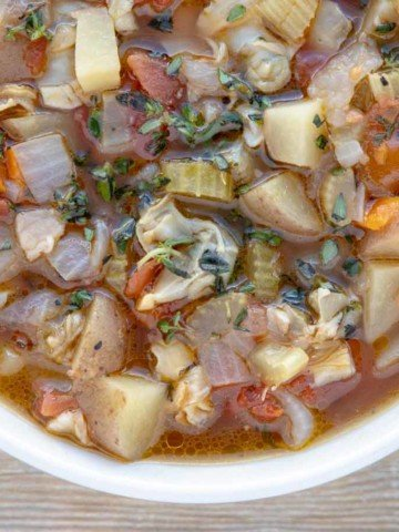 overhead partial shot of manhattan clam chowder in a bowl