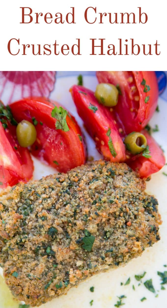 bread crumb crusted halibut and a tomato and olive salad on a white plate
