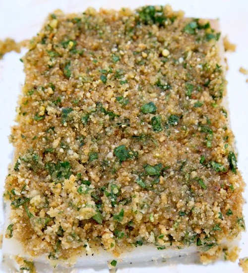 halibut with bread crumb mixture on a baking pan