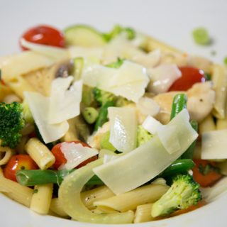Chicken Primavera Aioli in a white bowl