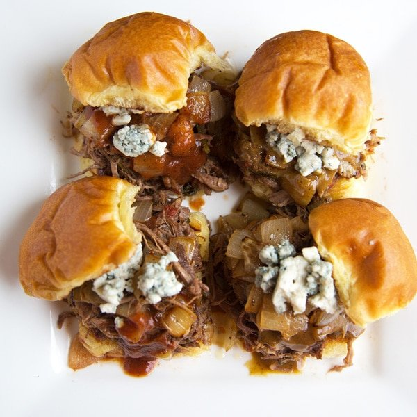 overhead view of Wild Boar Sliders with caramelized onion, bleu cheese crumbles and bbq sauce