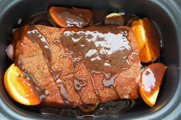 Pork with seasonings in a slow cooker