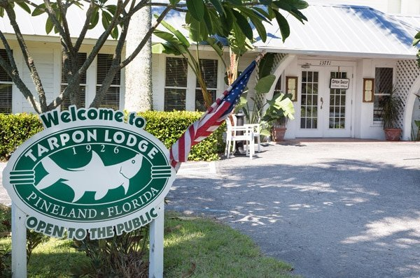 Welcome to Tarpon Lodge sign in front of the building