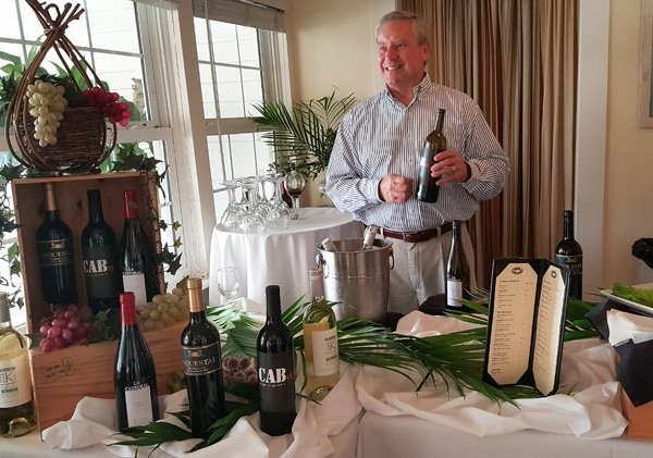 Man with bottle of wine during a wine tasting at Tarpon Lodge, Pine Island