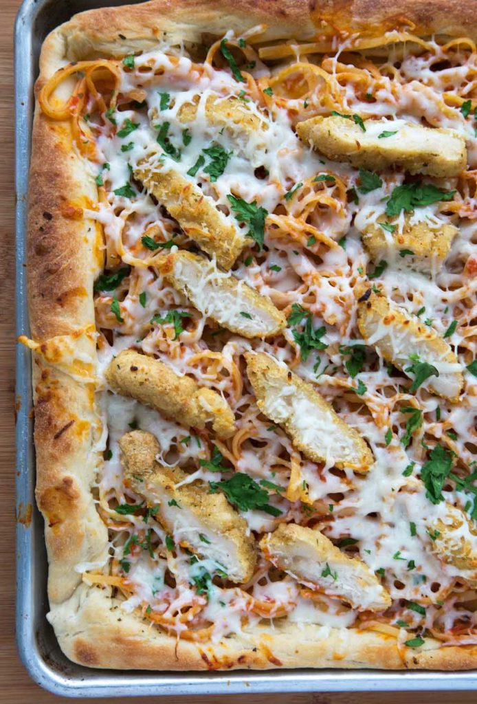 overhead shot of chicken parm pizza baked in a sheet pan