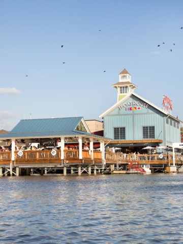 view of the Boathouse at Disney Springs from the water