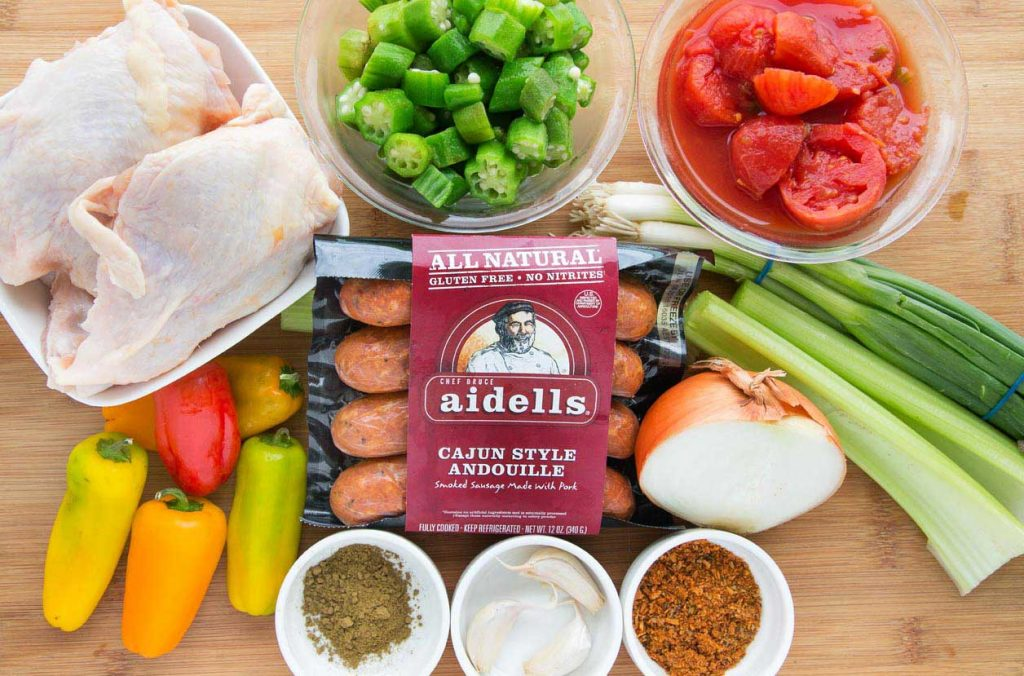 ingredients to make skillet chicken gumbo on a cutting board