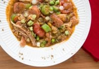 white bowl with chicken skillet gumbo and a red napkin on the side