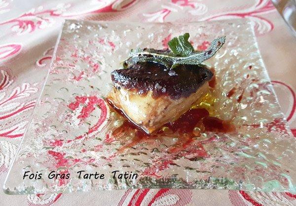 Fois gras tarte tatin on a glass plate