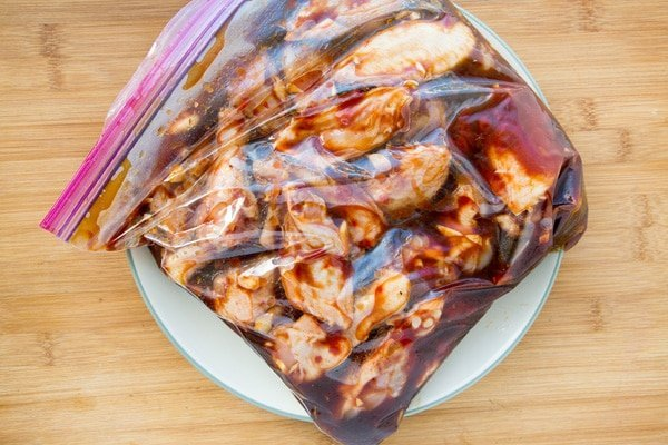 ziplock bag of chicken wings marinating