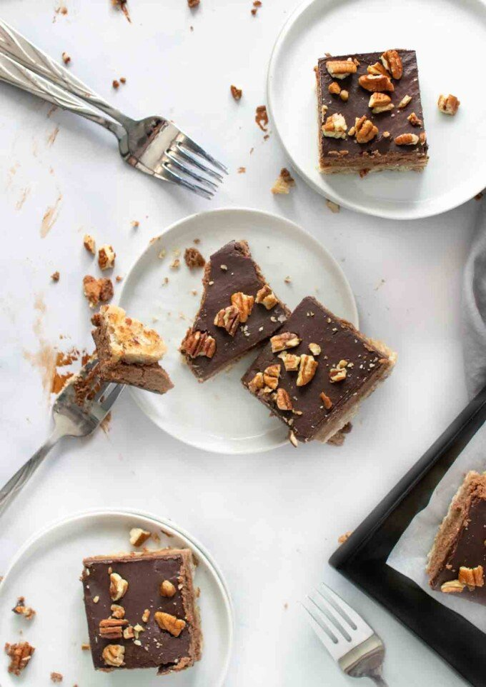 overhead view of plated slices of chocolate cheesecake bars