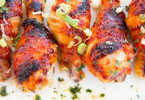 Asian Glazed Bacon Wrapped Chicken Legs