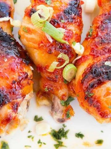 Asian Glazed Bacon Wrapped Chicken Legs