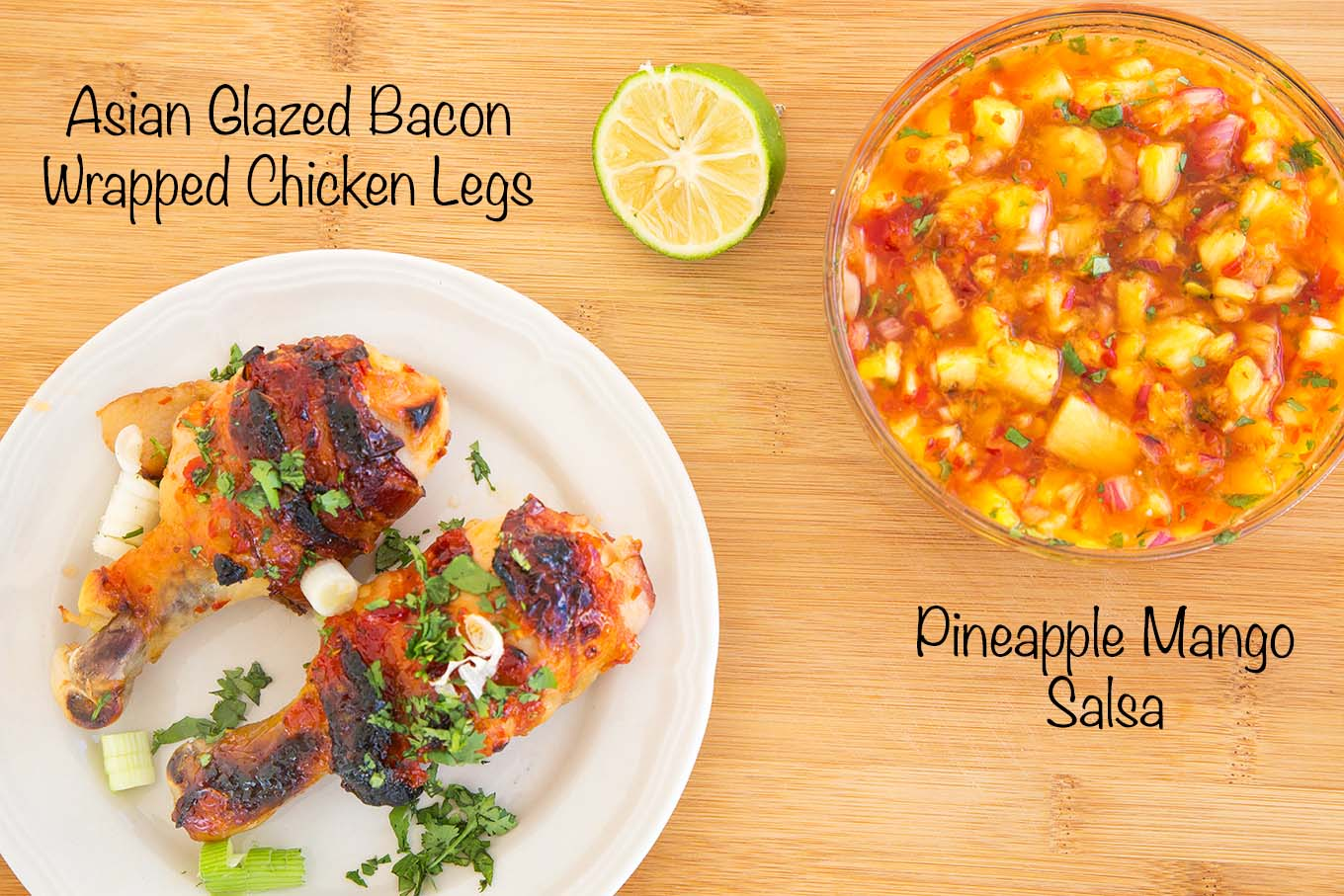 2 asian glazed bacon wrapped chicken legs on a white plate and a bowl of pineapple mango salsa