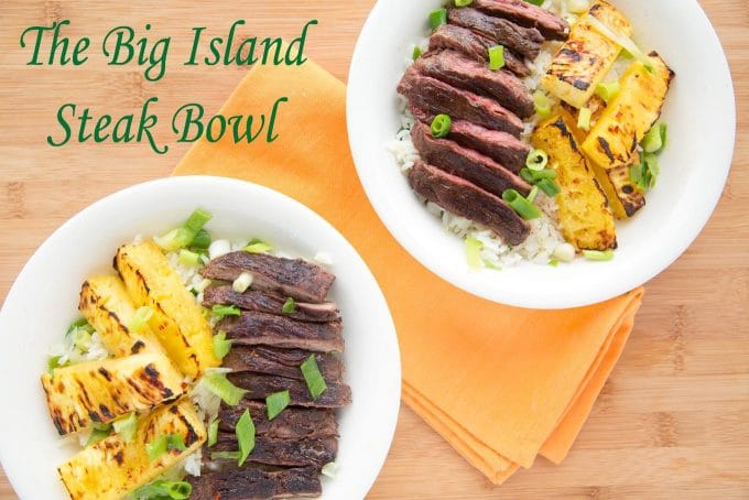 2 servings of grilled pineapple and grilled flank steak over rice in a white bowls