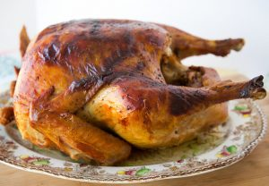 side view of a dry brine roasted turkey on a Thanksgiving platter