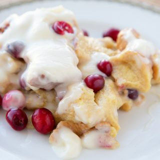 Cranberry Eggnog Bread Pudding with a Bourbon Cream Cheese Rum Frosting