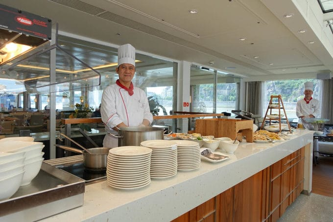 chef serving the buffet line at the Aquavit Terrace on a Viking River Cruise