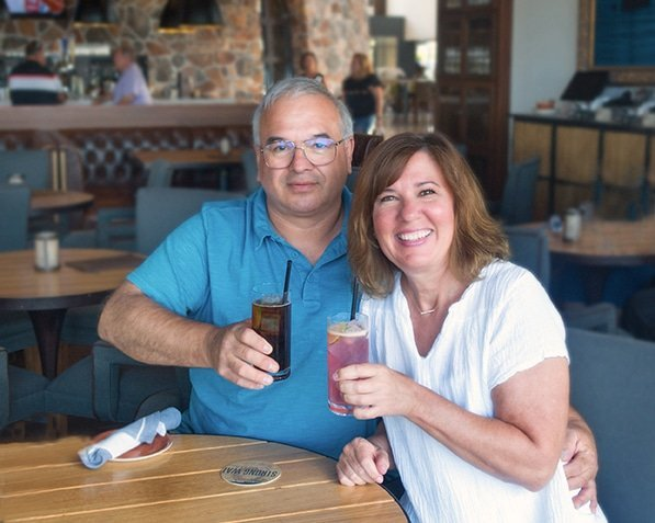 couple holding drinks at a table in the strong water tavern at loews sapphire falls