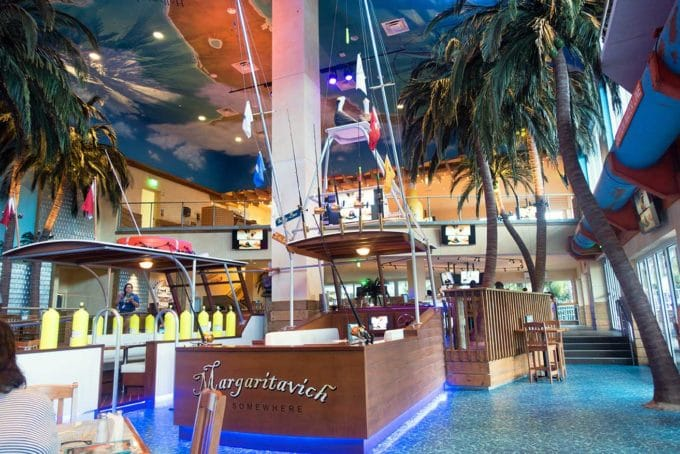 view of a boat and tables inside Jimmy Buffet's Margaritaville