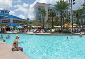 woman in bikini sitting at the pool at Loews Sapphire Falls Resort