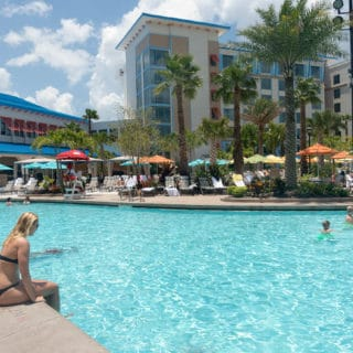 woman in bikini sitting at the pool at Loews Sapphire Falls Resort