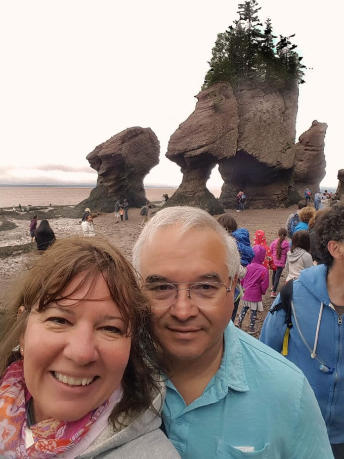 Chef Dennis and his wife in front of Hopewell Rocks