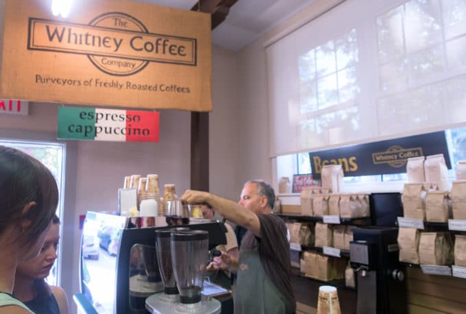 Man making Whitney Coffee at Fredericton Boyce farmers market