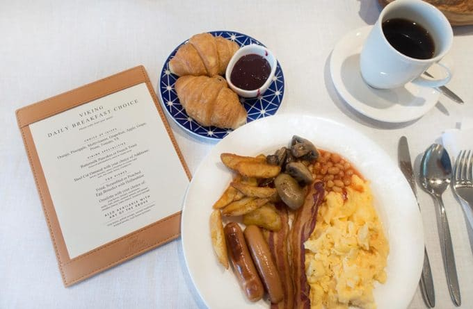 breakfast on a Viking longship, on a white plate with a menu , coffee and silverware on a white tablecloth