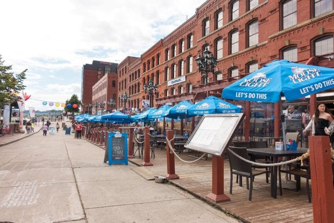 long building with awnings of restaurants on a street in saint John New brunswick