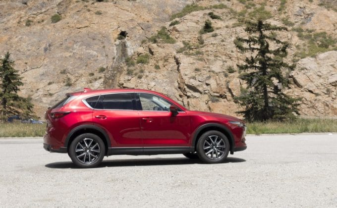 Soul Red Mazda CX-5 in front of a Mountain wall
