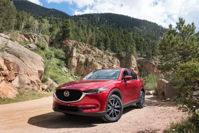 Soul REd Mazda CX-5 in front of the Rocky Mountains