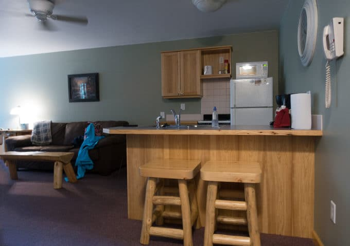 inside of our room at StoneBrook Resort on Fall River showing the living room and kitchen