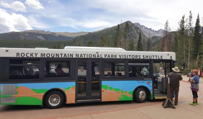 shuttle bus at Rocky Mountain national park with the rocky mountains in the background