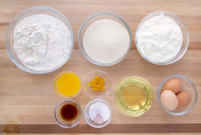 ingredients to make a yogurt cake in glass bowl