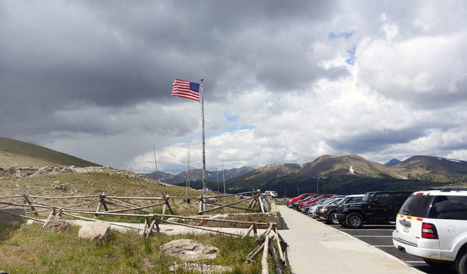 American Flag waving at the top of the mountain in Rocky Mountain National Park