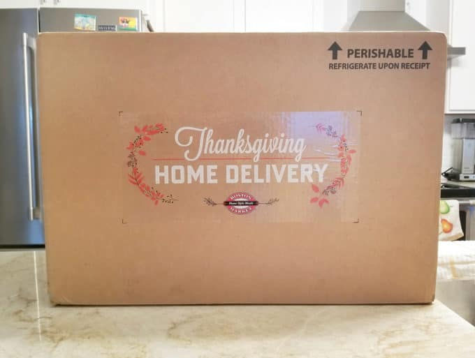 Large Cardboard Box with Thanksgiving Home Delivery by Boston Market sitting on a counter in a white kitchen