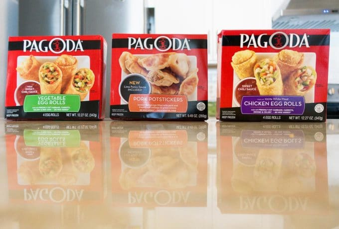 Pagoda eggrolls and pot stickers in retail packages sitting on a counter top in a kitchen