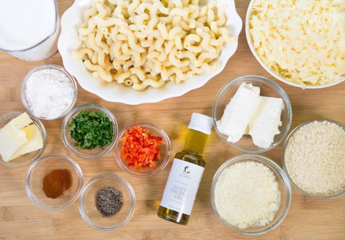 ingredients to make white truffle cheddar mac and cheese on a cutting board