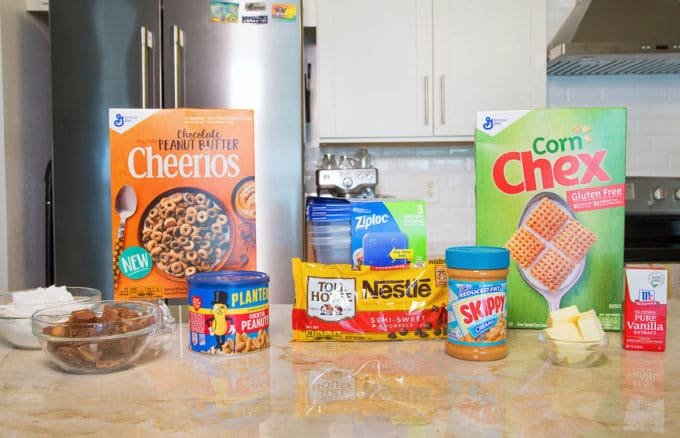 ingredients to make chex muddy buddies sitting on a kitchen counter