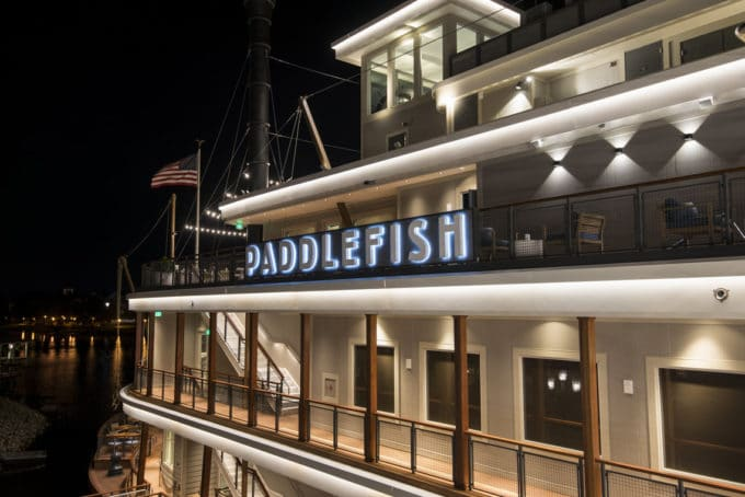 partial side view of the Paddlefish Restaurant at night time