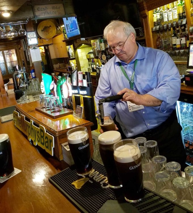 Chef Dennis pouring a pint of Gunniess at Murphy's Bar in Killarney Ireland