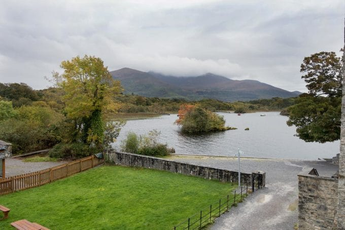 view of the mountains and lake from Ross Castle in Killarney Ireland