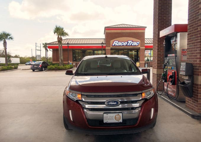 Red Ford Edge sitting at the gas pumps at RaceTrac