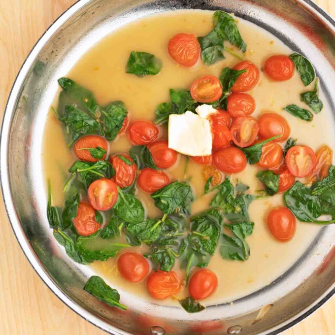 spinach, tomatoes and buerre manie added to court bouillon